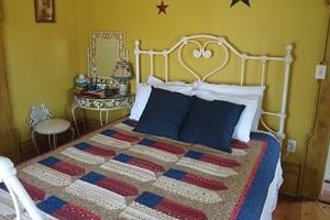 americana Room photo with bed and bedspread with flags on it.