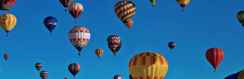 Colorful hot air balloons on a blue sky